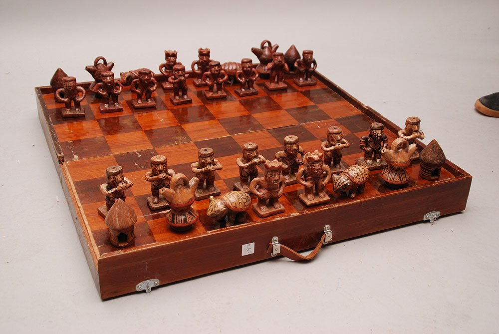 Chess set, wood case with South American pottery pieces