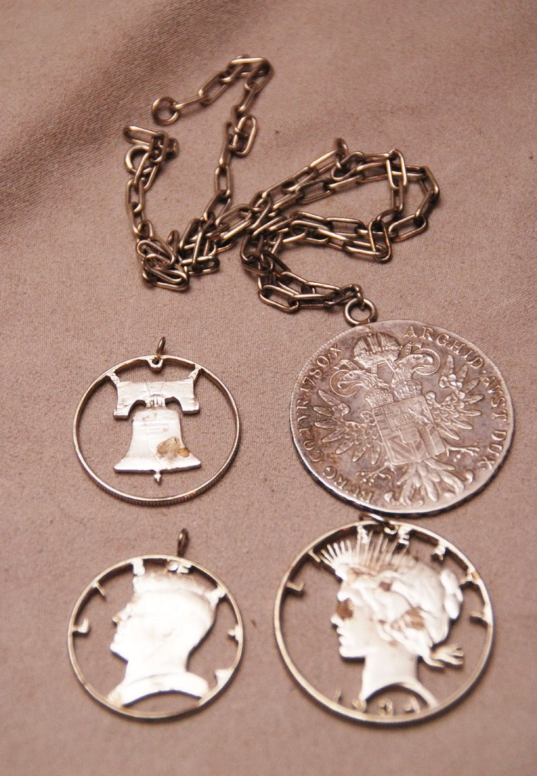 3 American laser cut silver coin pendants and 1 foreign