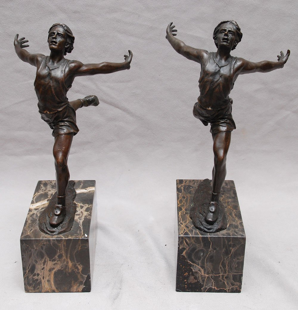 "Pair of bronze bookends on marble bases, runners, 8""h"