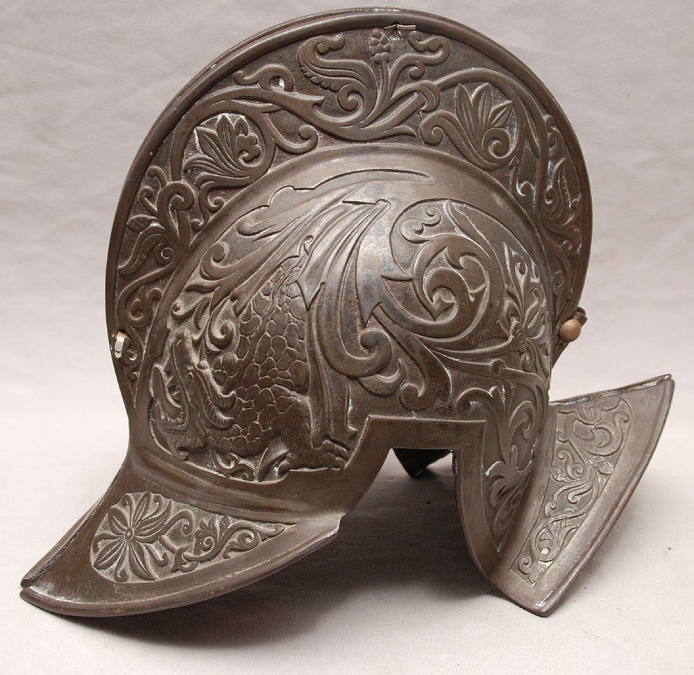"Antique bronze helmet, 17""h x 8""w"