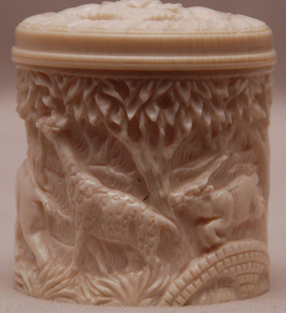 "Carved elephant ivory cylindrical box, 2""h x 2""w"
