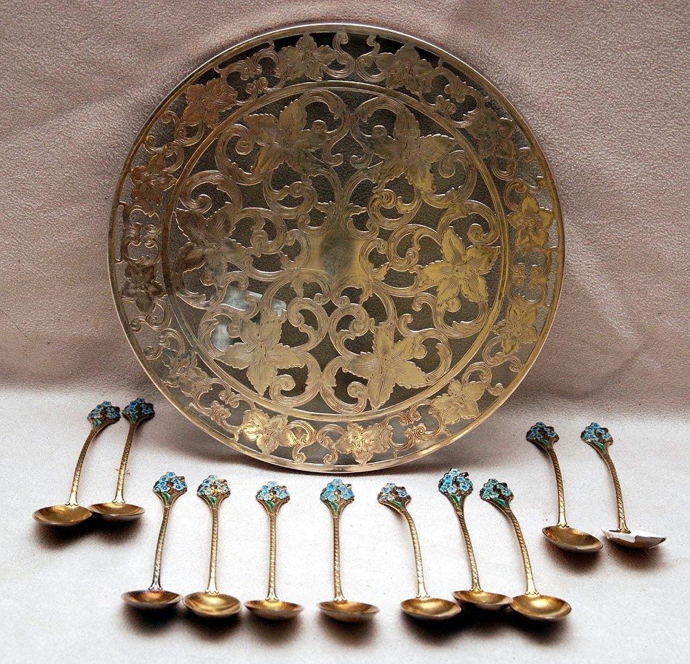 Sterling trivet and 11souvenir spoons, 13 oz. Including
