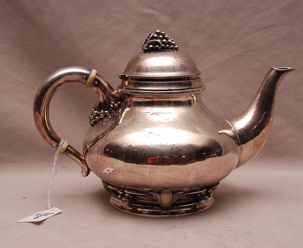 Danish Sterling Hand-Hammered Tea Pot.  Condition: very
