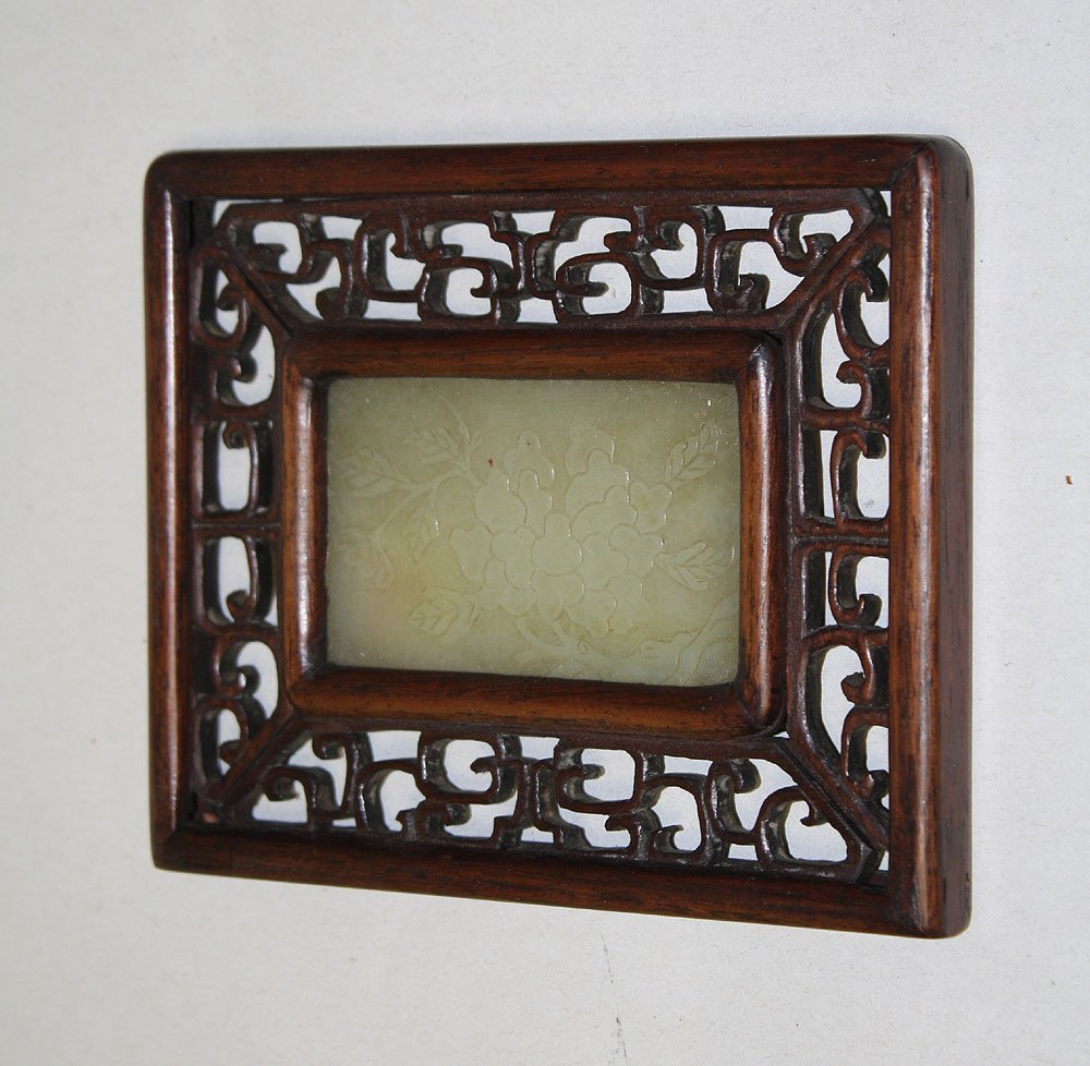 Early Carved Jade Pannel in carved wood frame.  Conditi