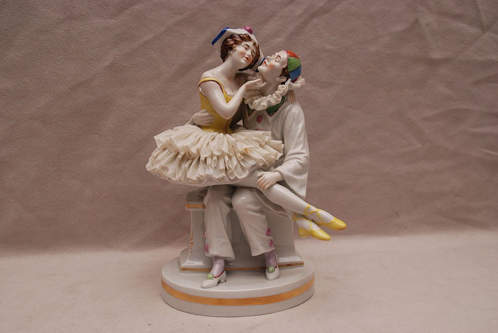 """German porcelain jester with seated dancer, 9""""h (some l"""