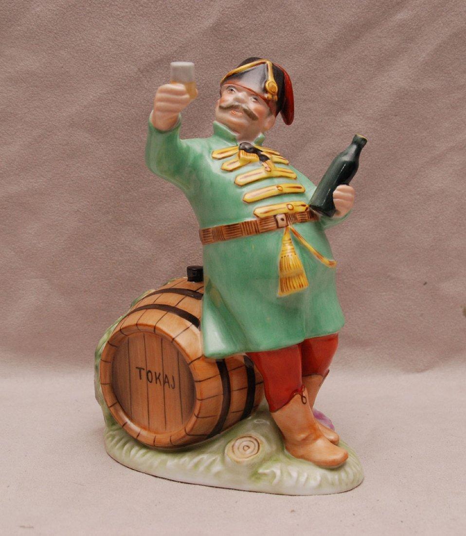"Herend fellow sitting on ""Tokaj"" barrel while holding l"