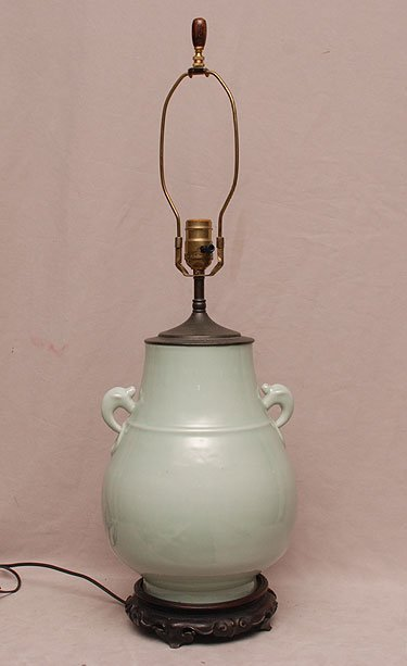 "Celadon porcelain lamp on carved Chinese base, 29""h (to"