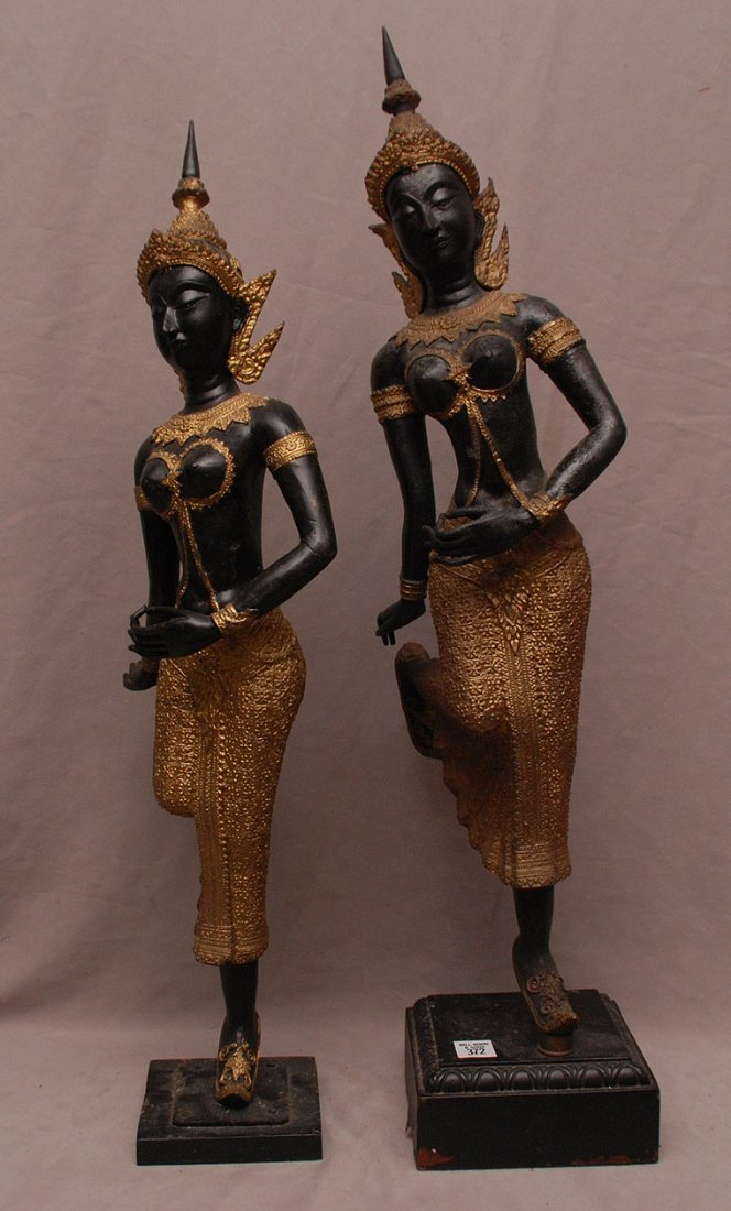 Pair of Bronze Balanese dancers on attached wood stands