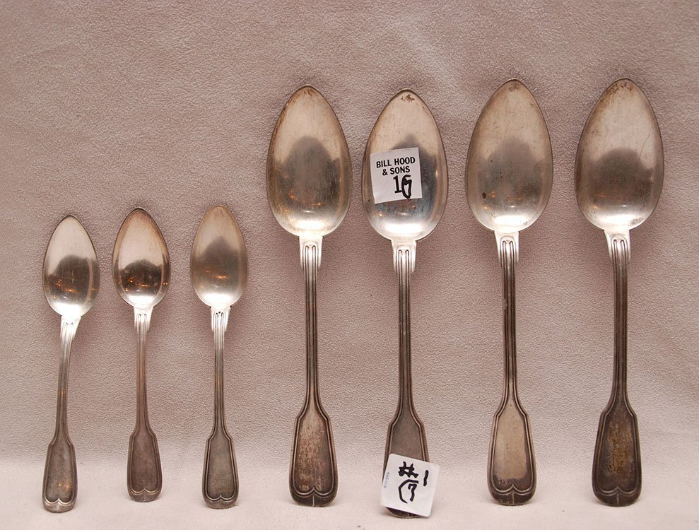 "Seven ""800"" silver pieces,  (4) table spoons and (3)"