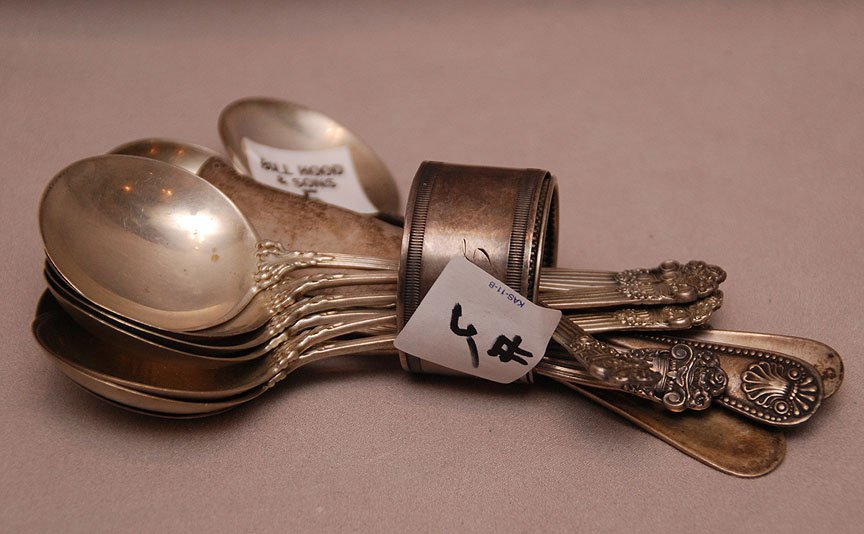 10 sterling soup spoons, 3 sterling butter knives and 2