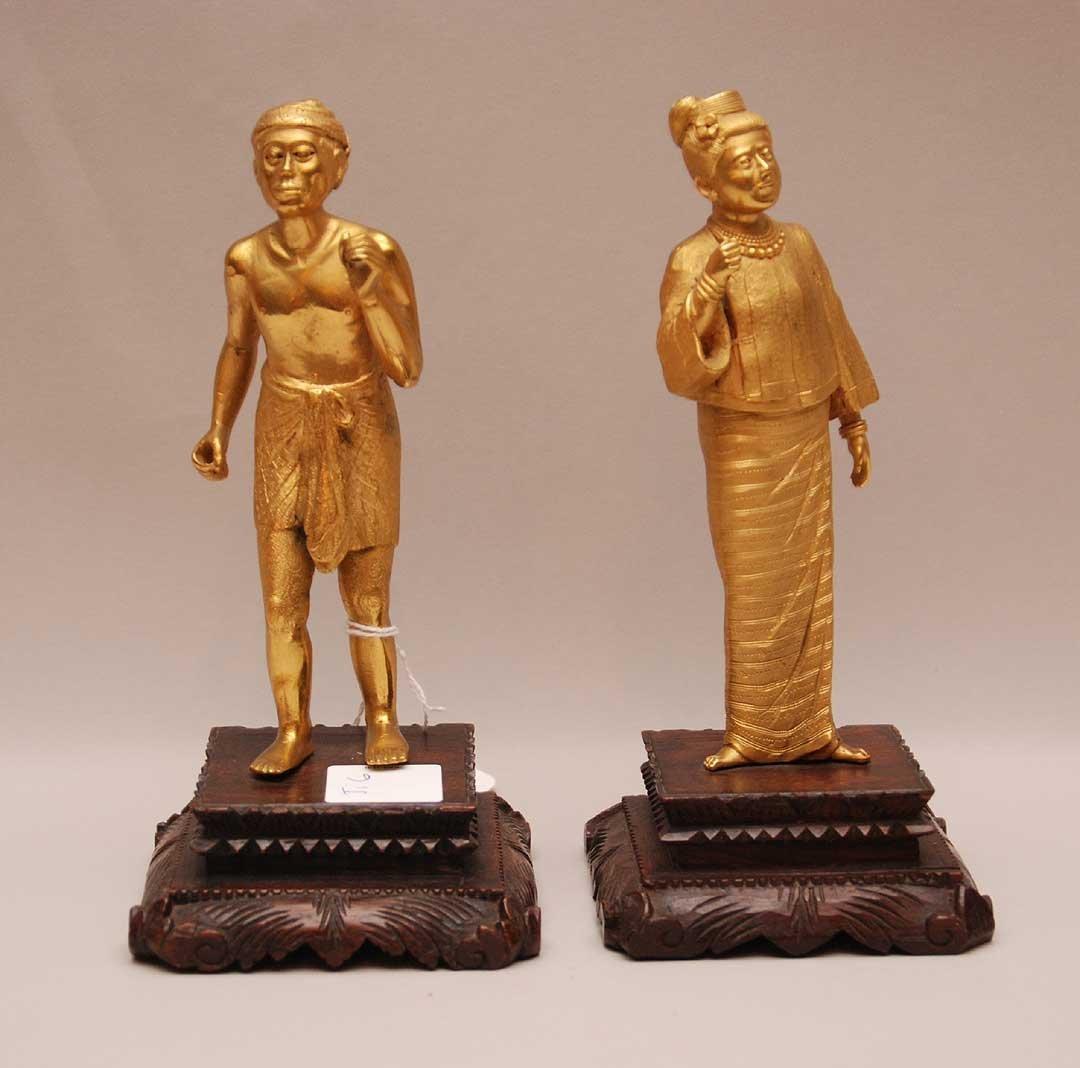 Pair Antique Gilt Bronze Oriental figures on carved woo