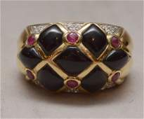 Ladies onyx ruby and diamond ring 14kt gold