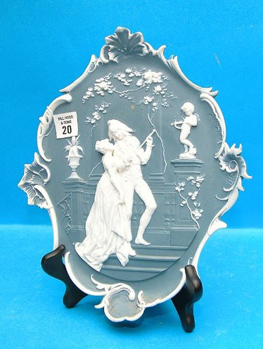 20: Wall plaque, blue and white, man and woman, putti w