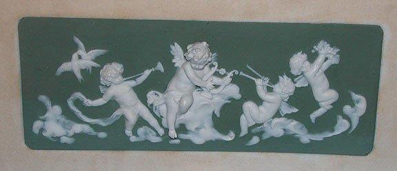 21A: German wall plaque in shadow box frame, 3 cherubs