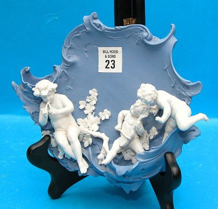 23: German Figural wall plaque, blue and white, 3 lyric