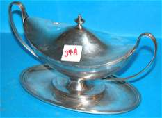 34A: English silver sauce tureen with attached under pl