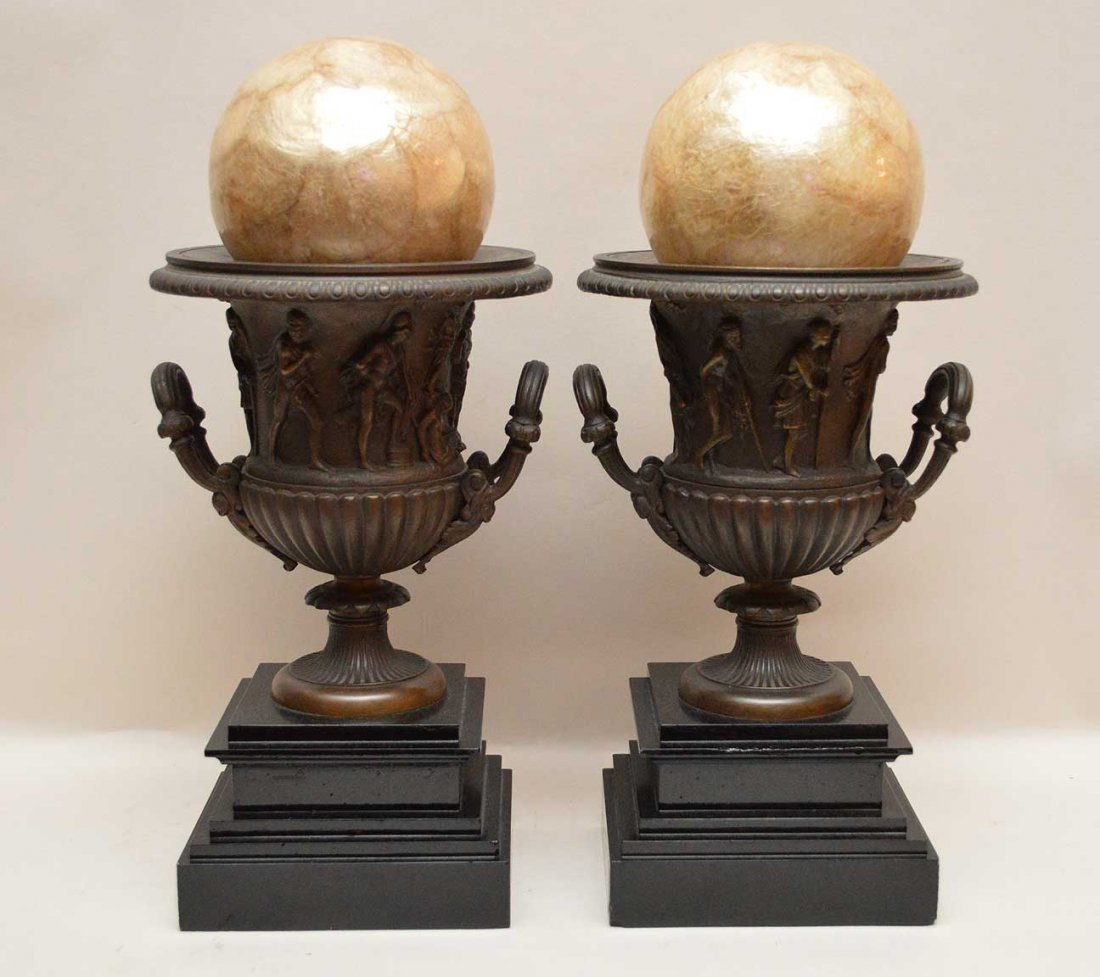 Pair Bronze Urns On Marble Bases.  One Urn has a crack