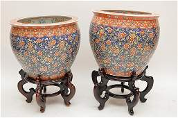 Pair of oriental fish bowls, multi colored with stands