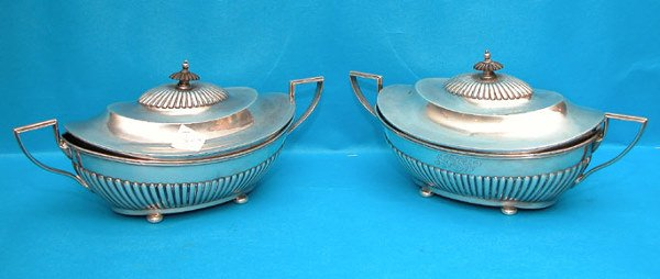 1008: Pair of oval sterling covered serving pcs.  w/ bu