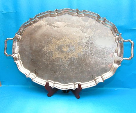 1010: (2) large silver plate platters, 1 footed