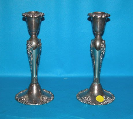 1016: Pair of elaborately decorated silverplate candle