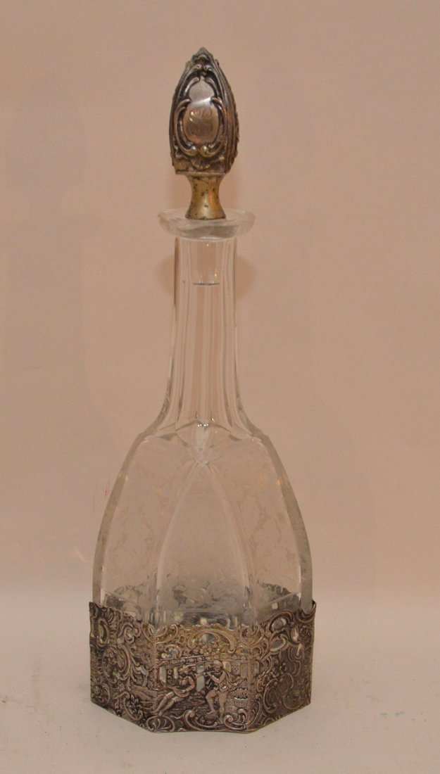 Etched glass decanter with European silver stopper and