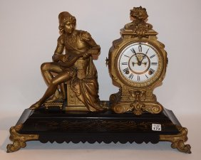 Gilt Metal & Ebonized Clock. Ht. 16 1/2""