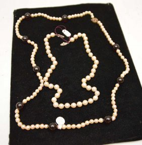 2 Pearl Necklaces, One With Red Beads