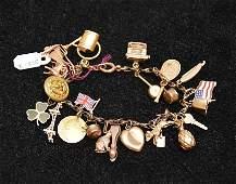 Gold charm bracelet, some charms marked 14kt