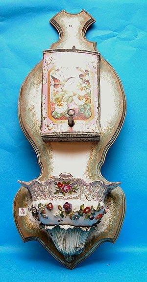 1018: Lavabo, porcelain flowers adorn vase at bottom se