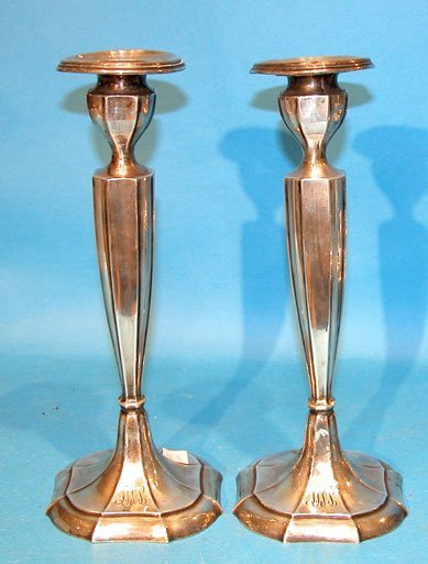1021: Pair of sterling silver candlesticks,  Weigh 22 o