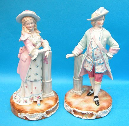 1025: Pair of French porcelain figurines, man & woman,