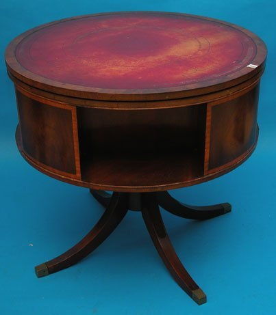 1083: Mahogany round revolving library or drum table, r