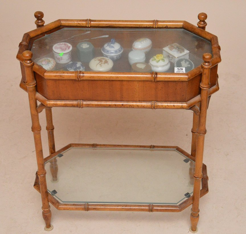 Diminutive bamboo style vitrine with porcelain boxes