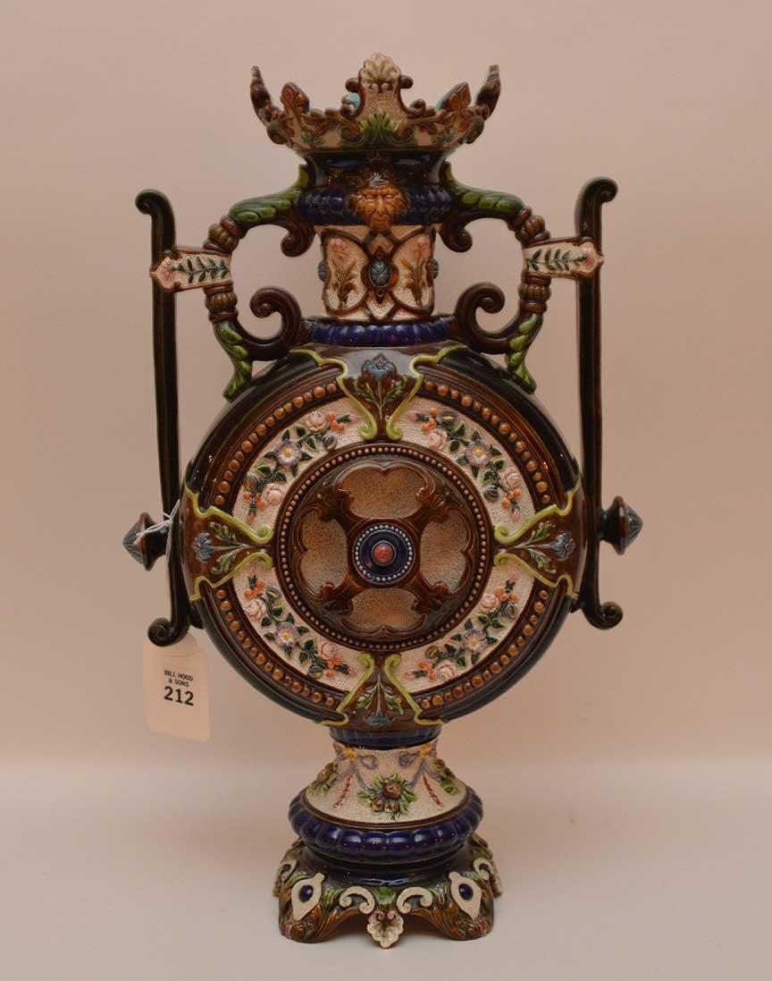 Oversized Majolica urn, ornately decorated, signed