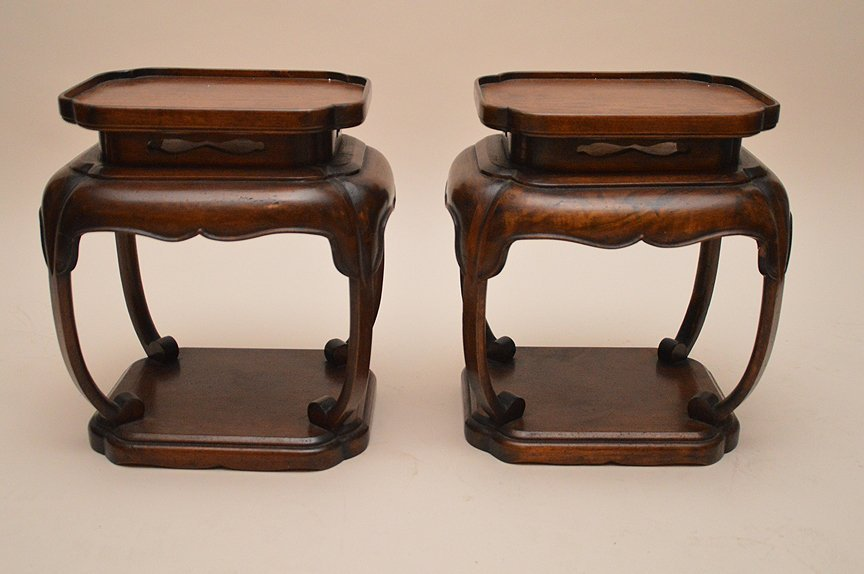 Pair oriental end tables with plank bottom shelf