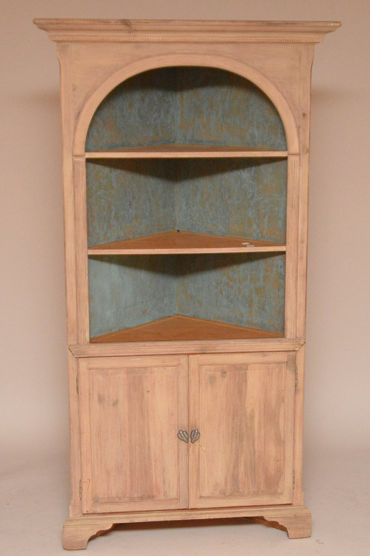 Light finished wood corner cabinet with 3 open shelves