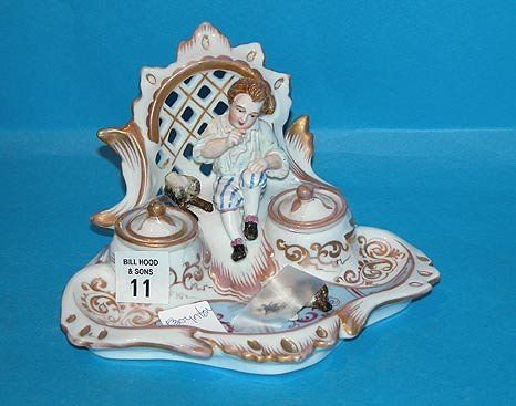 11: German porcelain inkwell, boy and dog; dog's head s