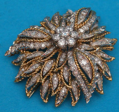 170: Brooch, 18kt yellow and white gold, with double cl