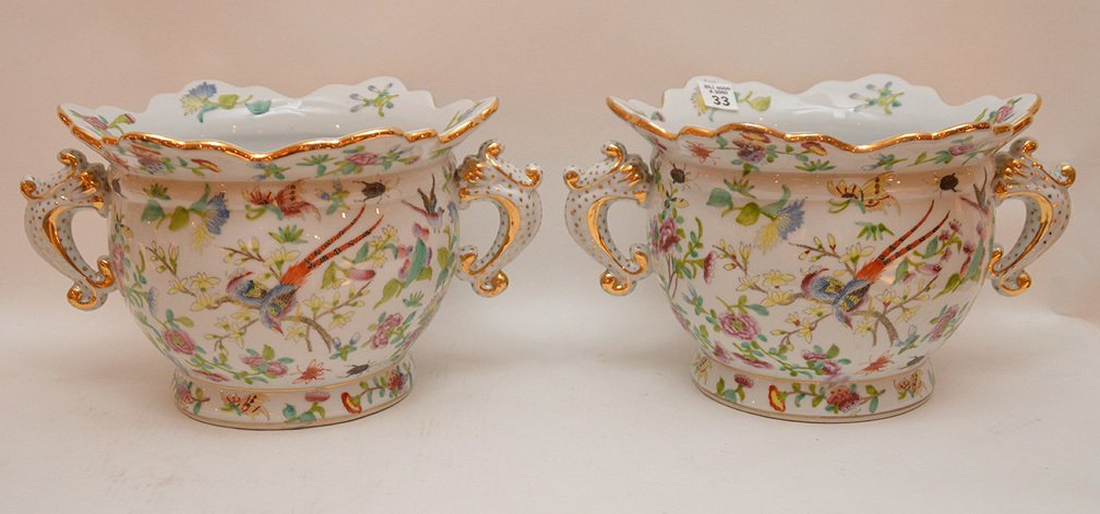 Pair of porcelain scalloped rim cache pots with fauna &
