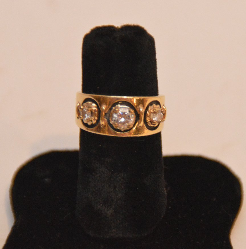 ladies 14kt yellow gold ring with 3 diamonds. Center - 3