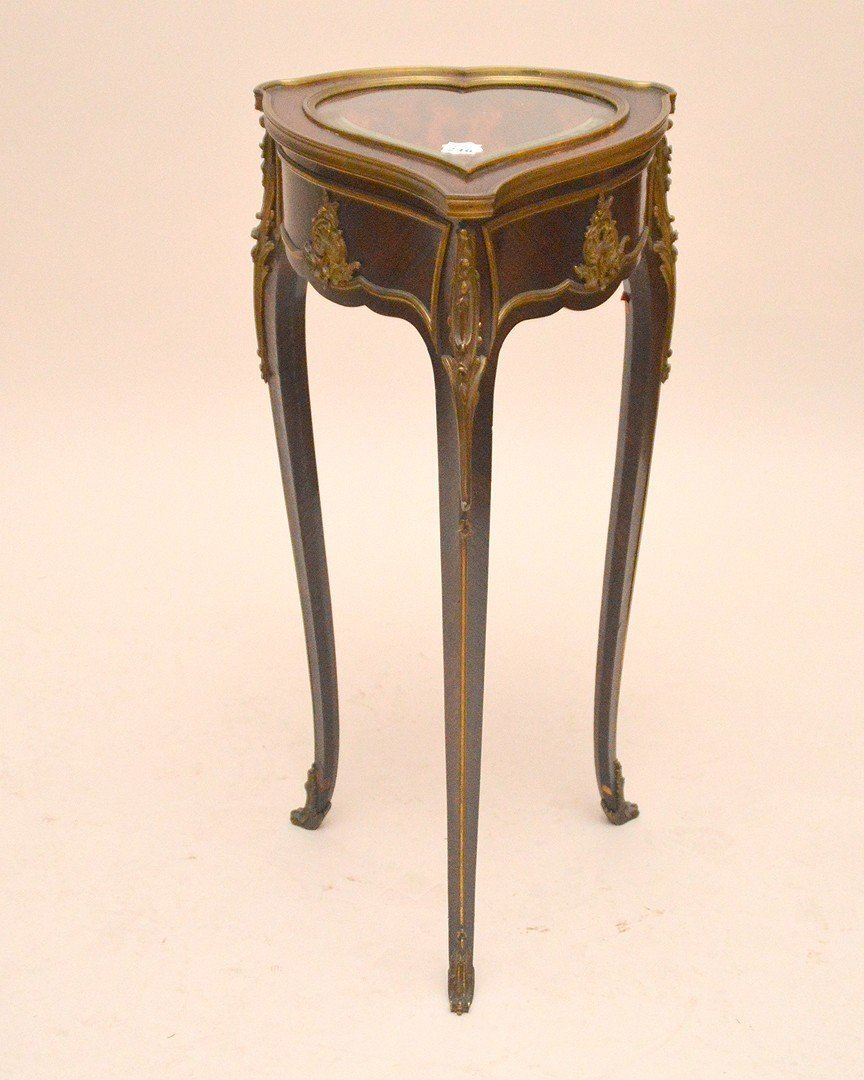 Rosewood heart form vitrine with gilt metal mounts,
