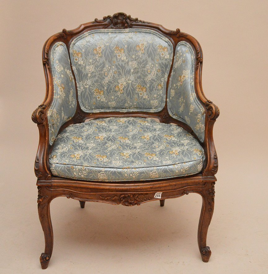 French carved walnut bergere with caned seat, blue
