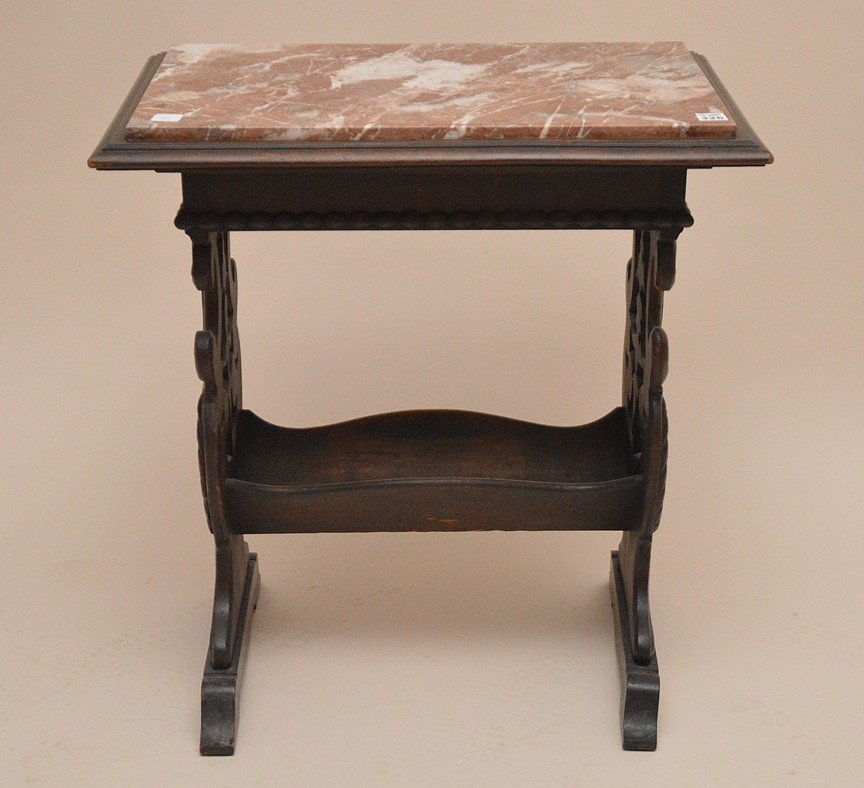 Marble top trestle style end table with book rack