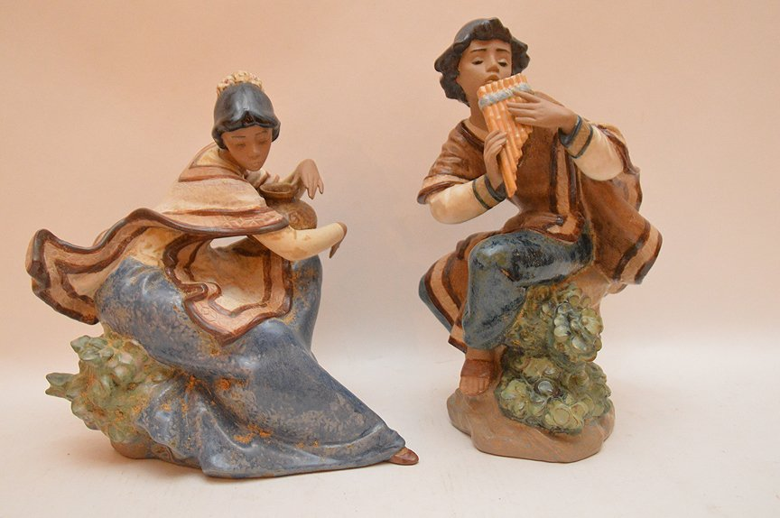 2 Lladro female figures, one playing instrument (11