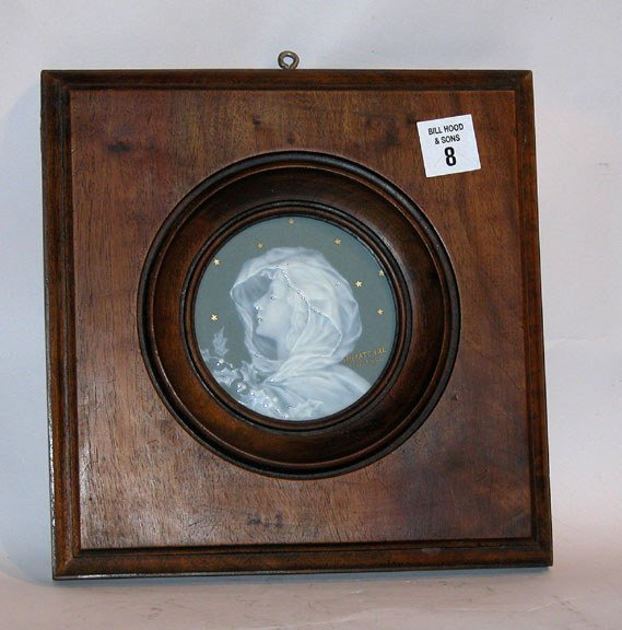 1008: Limoges round porcelain plaque of a woman in a wa