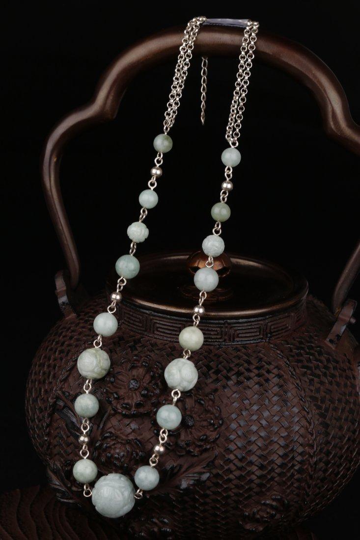 A Jadeite Bead With Decoration