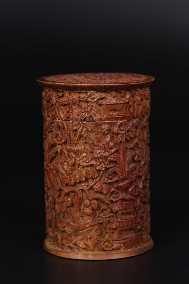 A Carved Wooden Case.