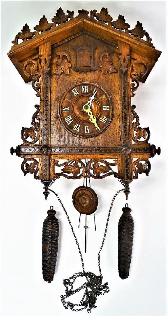 GERMAN CARVED WOOD CUCKOO CLOCK