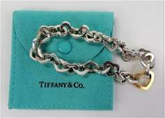 TIFFANY  CO 18KT Y GOLD  STERLING HEART BRACELET